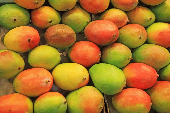 Mangos for sale at a market stall